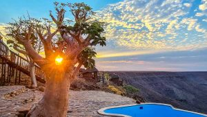 Namibia Rundreise Corona, Grootberg Lodge, Pool, Sonnenaufgang